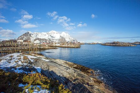 Henningsvær is a fishing village located in the Lofoten archipelago of Norway. The village draws many tourists because of its traditional fishing village architecture, and also climbing and diving/snorkeling. Standard-Bild