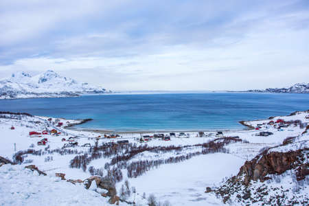 Grøtfjorden is a village located north-west of Tromsø. There is beautiful little fjord and small beach, that gets very crowded in the summer but becomes desolated and very quiet in the winter. Standard-Bild