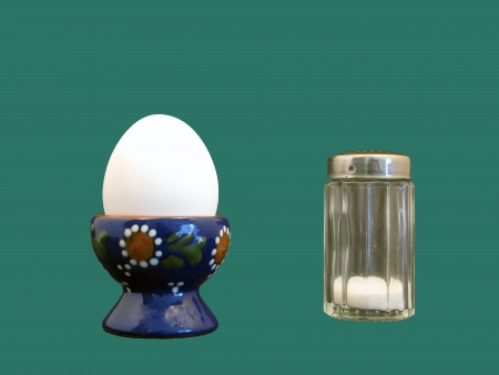 boiled egg with salt spreaders