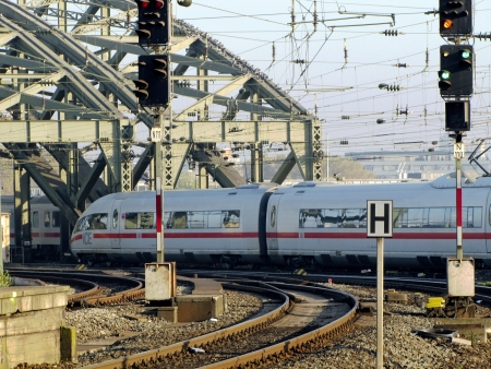 Hohenzollern Bridge Cologne central station with ICE