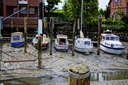 Boats in the harbor at low tide
