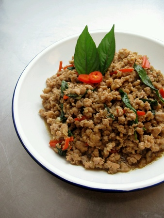 mincing: Stir Fried Minced Pork with Thai Basil Stock Photo