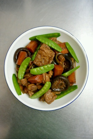 dinnertime: Chinese Food Pork Stew with Carrot Mushroom Snow Peas and Tofu Stock Photo
