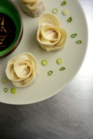 potstickers: Chinese Food Rose Shaped Pork Dumplings Potstickers Stock Photo