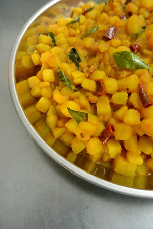 Malaysian Indian Food Potato with  Curry Leaves, Turmeric, Dried Chillies and Mustard Seeds