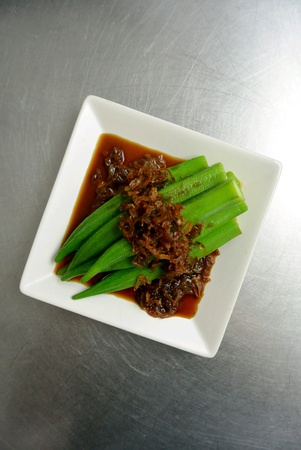 Malaysian Chinese Food Steamed Blanched Ladies Fingers Okra with Fried Shallots and Soy Sauce Stock Photo