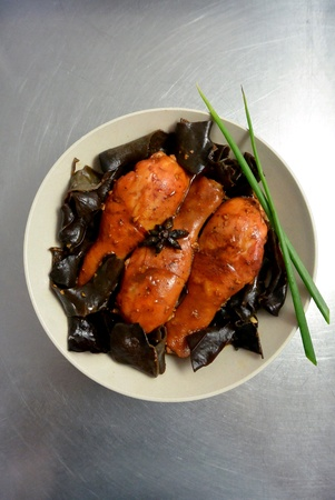 Malaysian Chinese Food Chicken Drumstick and Wood Ear Fungus Braised with Red Fermented Bean Curd 版權商用圖片 - 112138314