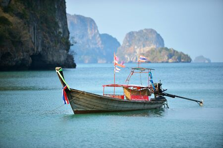 Sea view with long tail boat and mountain at Riley Beach, Krabi Province, Thailand