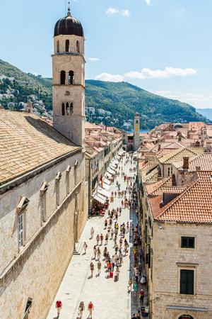 DUBROVNIK, CROATIA - JULY 16th, 2016: Franciscan Church and Monastery at Stradun (Placa), from Pile Gate to Clock Tower, in the Old Town in a sunny summer day.