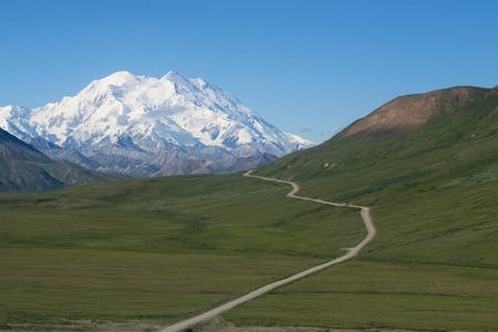 A winding road leading to Mt  McKinley in Denali National Park, Alaska  photo