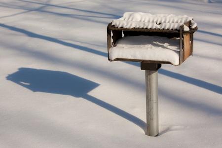 Winter scene of a snow covered grill  Archivio Fotografico