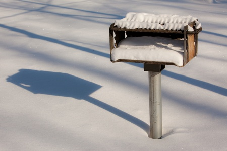 frigid: Winter scene of a snow covered grill  Stock Photo