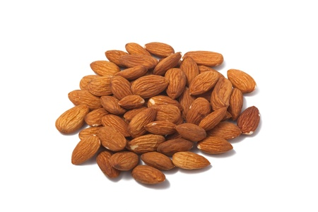 allergic ingredients: A photo of almond nuts isolated on a white background.