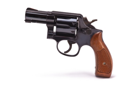 A photo of snub nose revolver isolated on a white background. This handgun was a standard issue weapon for police detectives for many years. Stock fotó