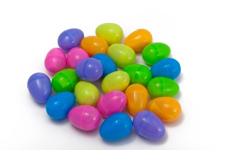 A grouping of multi-colored plastic Easter eggs isolated on a white background. Stock fotó