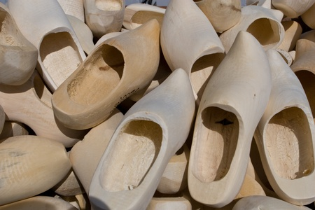offered: pile of sooden shoes offered for sale  Stock Photo