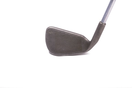 the head of a golf iron isolated on white
