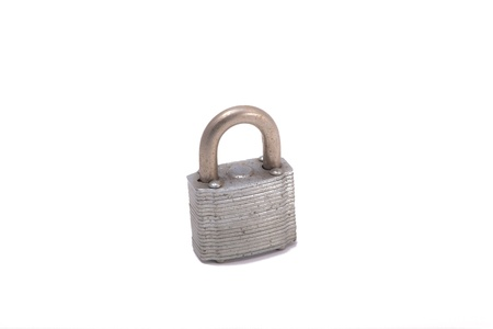 Photo of an old rusty padlock isolated on white.