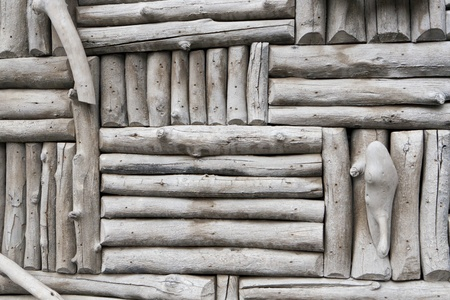 This is a closeup photo of a gray log exterior wall that is suitable for a background