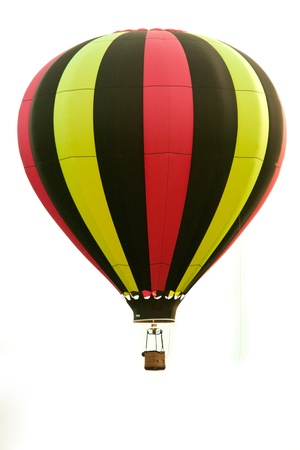 air balloon: This  photo shows a hot air balloon in flight isolated on a white background