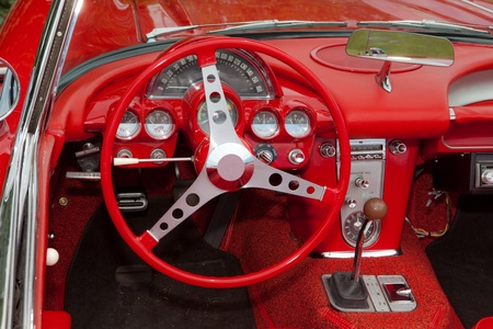 chevy: This is a photo of the dashboard and steering wheel of a 1962 Corvette. Stock Photo