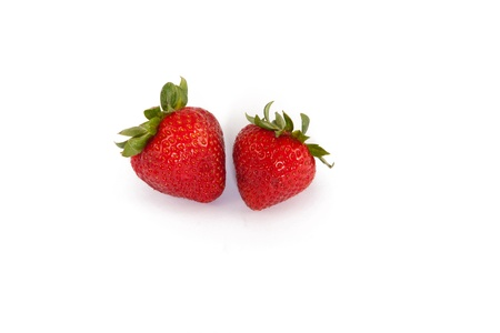 This is a photo of two fresh strawberries isolated on a white background.