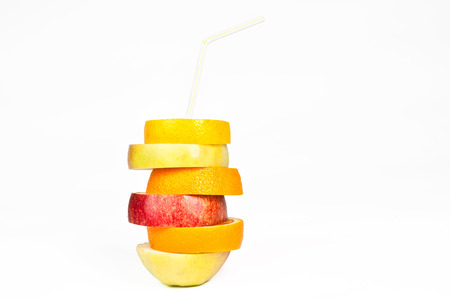 Stack of orange, lemon, pear and apple slices with straw juice concept isolated on white photo