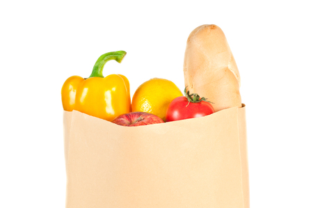 Fresh healthy groceries in a paper bag isolated on white background