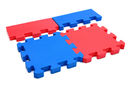 Blue and red puzzle on white