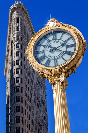 fifth avenue: NEW YORK - 04062017: the Fifth Avenue Building clock in front of Flatiron building on April 6, 2017 in New York City in the morning.