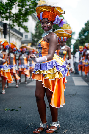 antilles: Paris, France - July 6, 2013: young female dancer performing on streets of Paris at the annual summer tropical carnival. This carnival takes place every year in july in Paris 11th district.
