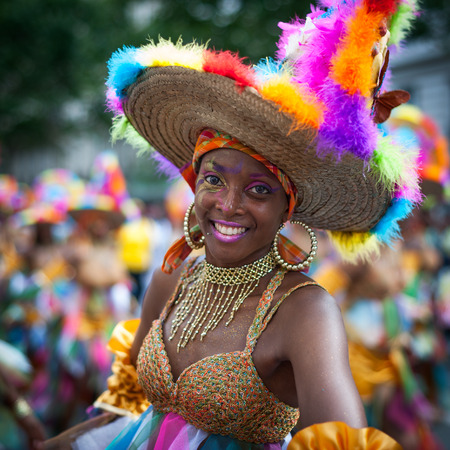 Paris, France - July 6, 2013: young female dancer performing on streets of Paris at the annual summer tropical carnival. This carnival takes place every year in july in Paris 11th district.