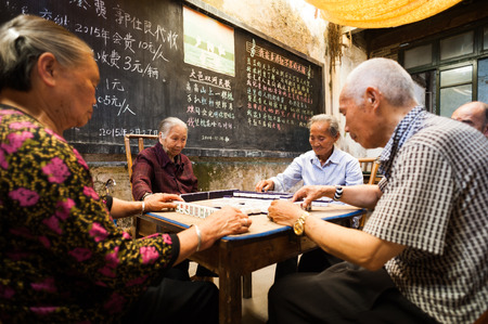 sichuan province: Chongzhou, Sichuan Province, China - May 30, 2015: Old chinese people playing Mahjong in a tearoom.