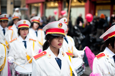 fanfare: Paris, France - Jan 28, 2012: Chinese fanfare at the chinese lunar new year parade.