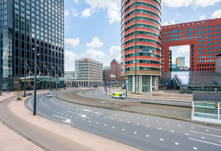 dutch culture: Rotterdam, Netherlands - March 24, 2014: A road and modern buidlings in Rotterdam.