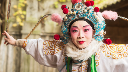 arts culture and entertainment: Chengdu, Pixian, Sichuan Province, China - Nov 15, 2015: Actor of Sichuan Opera preparing with make-up in front of a mirror.