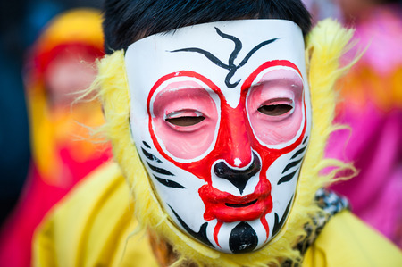 Paris, France - Feb 17, 2013: Chinese performer wearing a monkey mask in traditional costume at the chinese lunar new year parade Editorial
