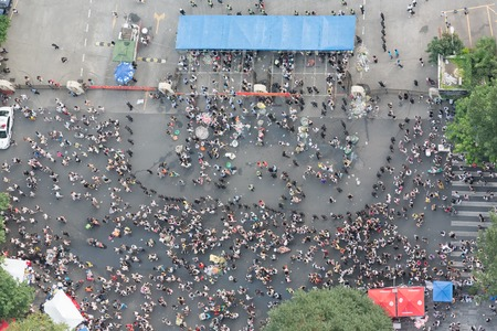 Chengdu, Sichuan Province, China - July 3, 2016: Crowd wainting to enter a concert vertical high angle view