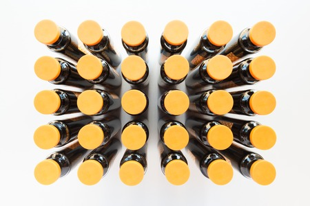 30 medicine ampules with orange cap vertical wide angle shot on white background