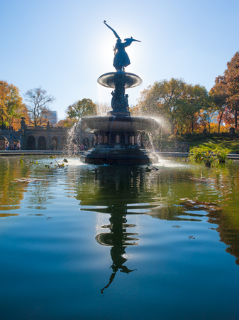 bethesda: Bethesda Fountain against sun with angel statue reflecting in the water surface