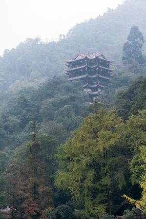 Temple in the haze in the Dujiangyan mountain Stock Photo