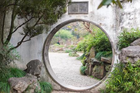 Circle traditional door in  Zhuozhengyuan park - Suzhou
