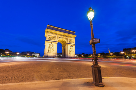 Place Charles de Gaulle at night with illuminated Arc de Triomph Stock Photo