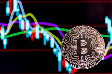 electronic background: Bitcoin with colorful charts in the background