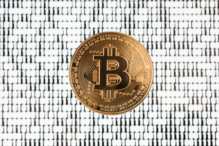 electronic background: Bitcoin on binary code blurred background Stock Photo