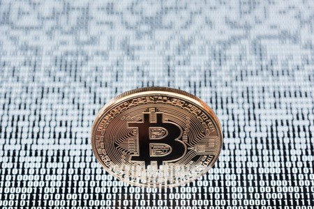 electronic background: Bitcoin on binary code background