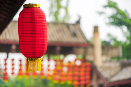 tradition: Red chinese lanterns in a chinese park Stock Photo