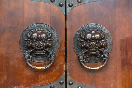 Dragon Chinese Door Knocker On A Brown Wooden Gate Stock Photo   88222765