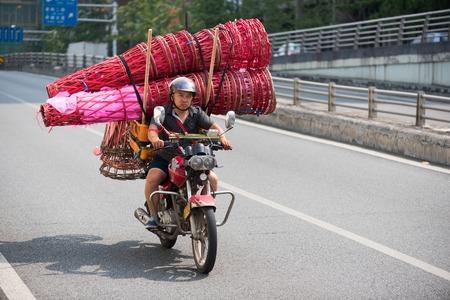Chinese man on motorbike