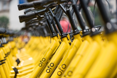 road bike: Rows of yellow OFO station-free shared bikes Editorial